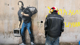 Why Banksy's New Mural Paints Steve Jobs as a Syrian Refugee