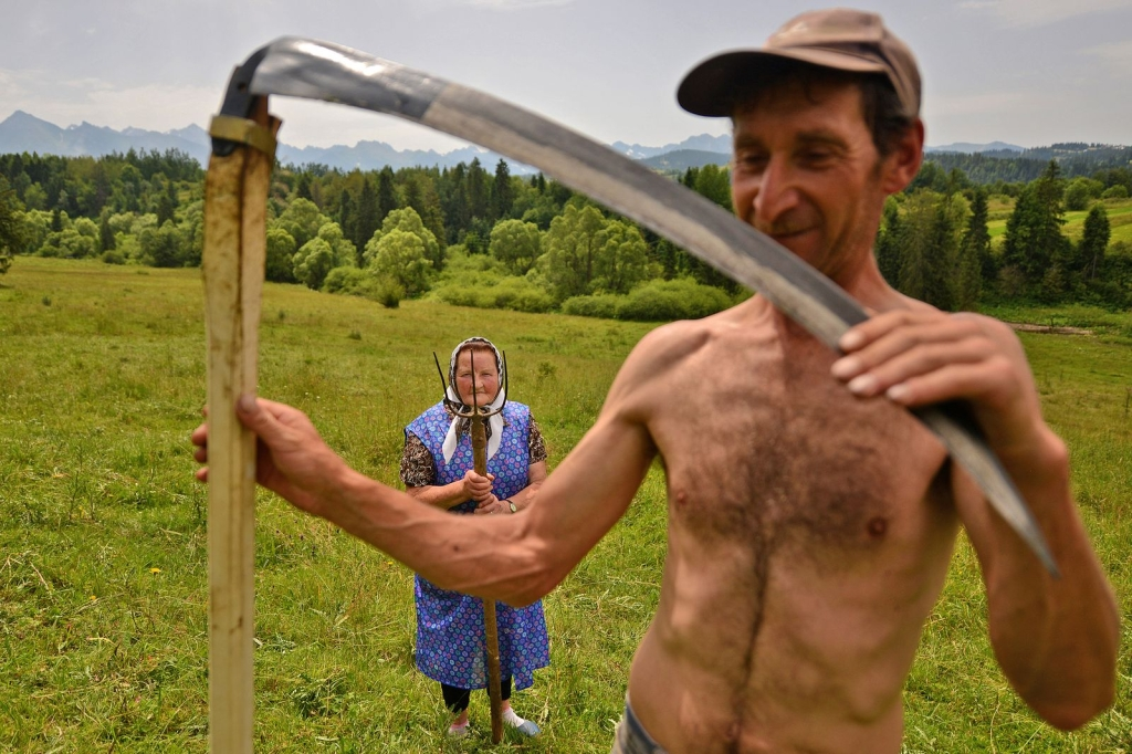 Photo and caption by Bartłomiej Jurecki Traditional haymaking in Poland. Many people continue to use the scythe and pitchfork to sort the hay.