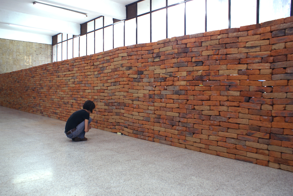 A Single Book Changes an Entire Wall in This Powerful